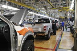 In this Sept. 27, 2018, file photo a United Auto Workers assemblymen work on a 2018 Ford F-150 trucks being assembled at the Ford Rouge assembly plant in Dearborn, Mich.