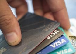 This Aug. 11, 2019 file photo shows Visa credit cards in New Orleans
