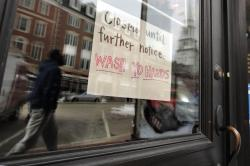 n this March 25, 2020, file photo, a closed sign hangs in the window of a shop in Portsmouth, N.H.