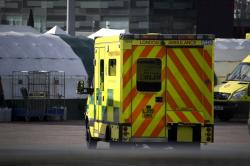 Ambulances and camp tents are seen outside the Excel in London, Saturday, March 28, 2020