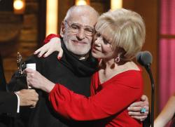 "Larry Kramer, left, and Daryl Roth embracing after they won the Tony Award for Best Revival of a Play for ""The Normal Heart"" during the 65th annual Tony Awards in New York."