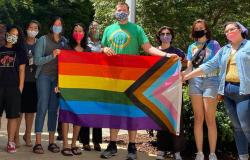 Sacramento City Councilman Steve Hansen, center, joined with LGBTQ members of his city's youth commission June 11 to raise the Progress Pride flag at City Hall