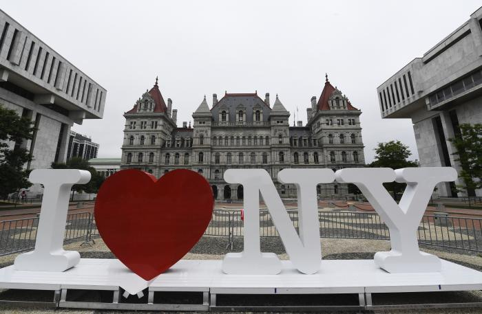 "A new promotional ""I Love NY"" sign sits in the Empire State Plaza for installation in front of the New York state Capitol in Albany, N.Y."