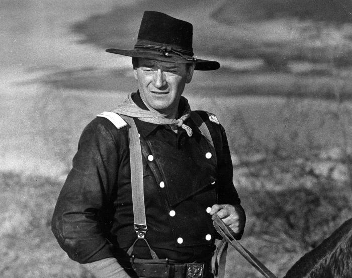 "John Wayne appears during the filming of ""The Horse Soldiers."""
