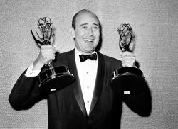 """Carl Reiner shows holds two Emmy statuettes presented to him as best comedy writer for the """"Dick Van Dyke Show"""" in 1963."""