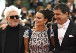 Director Pedro Almodovar, from left, actors Penelope Cruz and Antonio Banderas pose for photographers upon arrival at the premiere for the film 'Pain and Glory' at the 72nd international film festival, Cannes, southern France, Friday, May 17, 2019.
