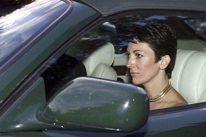 British socialite Ghislaine Maxwell, driven by Britain's Prince Andrew leaves the wedding of a former girlfriend of the prince, Aurelia Cecil, at the Parish Church of St Michael in Compton Chamberlayne near Salisbury, England.
