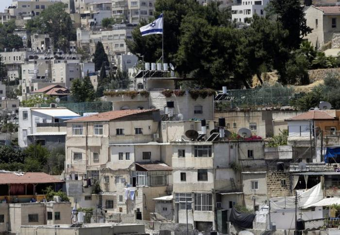 An Israeli flag flies over a Jewish owned house in a Palestinian neighborhood of Silwan in east Jerusalem, Wednesday, July 1, 2020