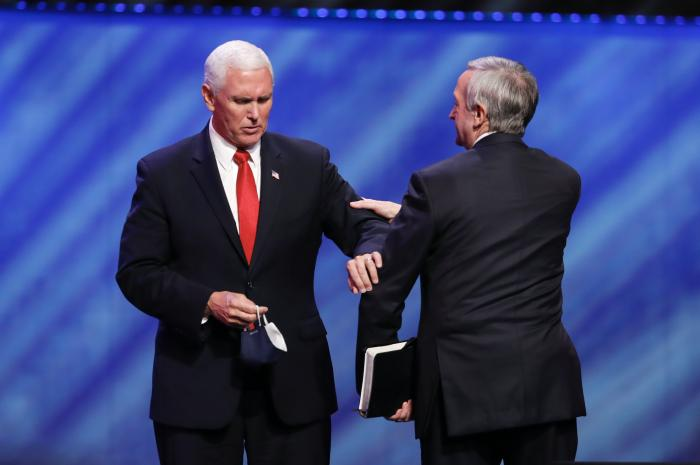 Vice President Mike Pence, left, greets Senior Pastor Dr. Robert Jeffress, right, after Pence spoke at the Southern Baptist megachurch First Baptist Dallas during a Celebrate Freedom Rally in Dallas, Sunday, June 28, 2020