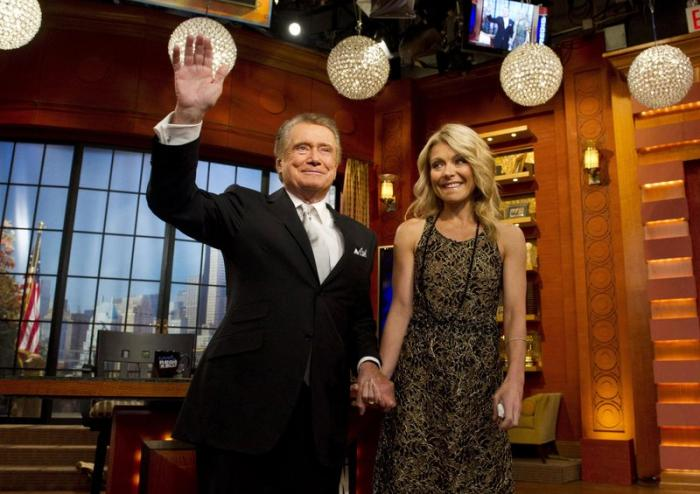 """Regis Philbin and Kelly Ripa appear on Regis' farewell episode of """"Live! with Regis and Kelly"""", in New York."""
