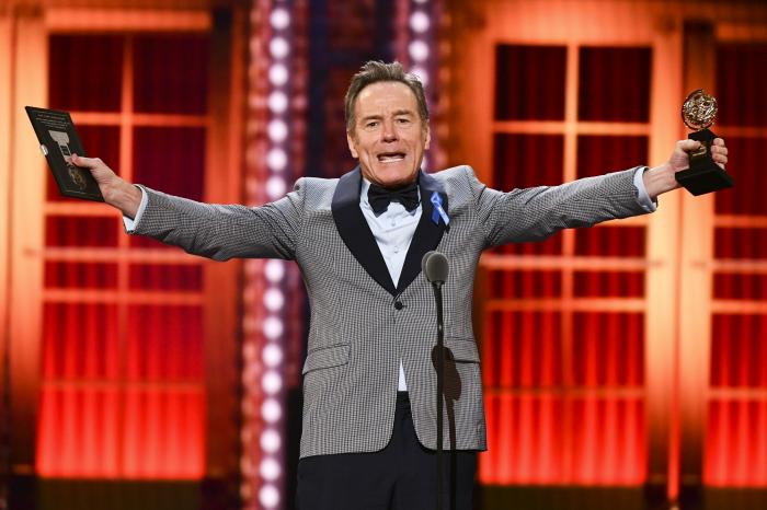 "Bryan Cranston accepts the award for best performance by an actor in a leading role in a play for ""Network"" at the 73rd annual Tony Awards."