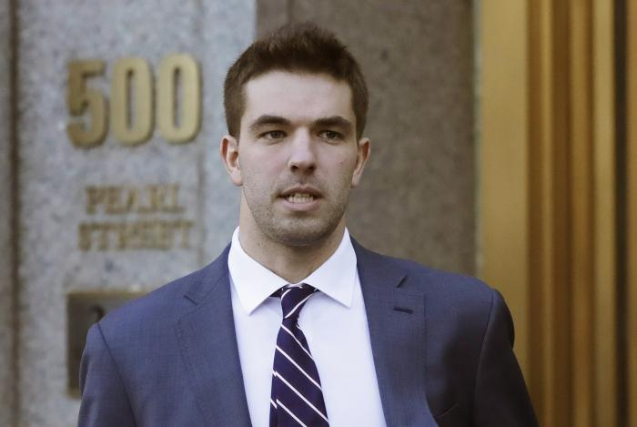 In this March 6, 2018 file photo, Billy McFarland, the promoter of the failed Fyre Festival in the Bahamas, leaves federal court after pleading guilty to wire fraud charges in New York.