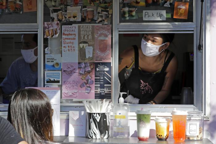 Kaye Fan, right, calls out orders as she works in her Dreamy Drinks food truck.
