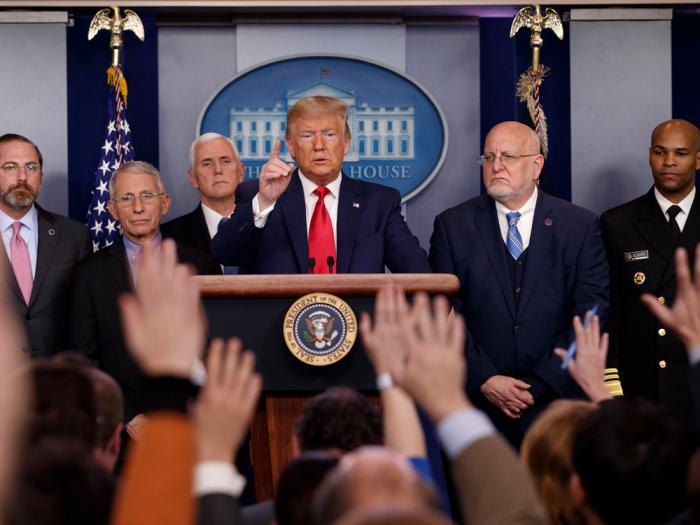 In this Feb. 29, 2020, file photo President Donald Trump, center, points as he prepares to answer question after speaking about the coronavirus in the press briefing room at the White House in Washington, as Health and Human Services Secretary Alex Azar, National Institute for Allergy and Infectious Diseases Director Dr. Anthony Fauci, Vice President Mike Pence, Robert Redfield, director of the Centers for Disease Control and Prevention and U.S. Surgeon General Dr. Jerome Adams listen