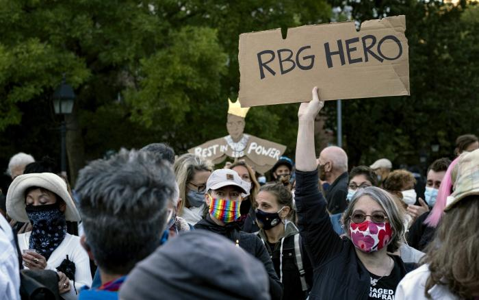 People gather at Washington Square Park in New York Saturday, Sept. 19, 2020, a day after the death of Justice Ruth Bader Ginsburg. (AP Photo/Craig Ruttle)