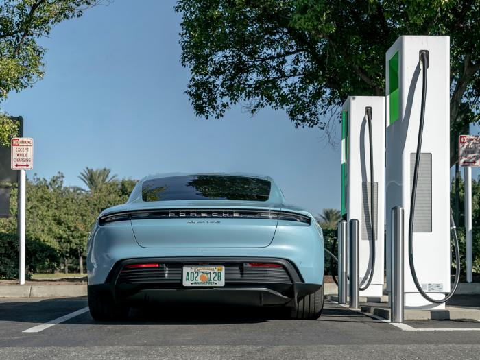 This photo provided by Porsche shows its first all-electric production car, the 2020 Taycan, charging up at a public charging station