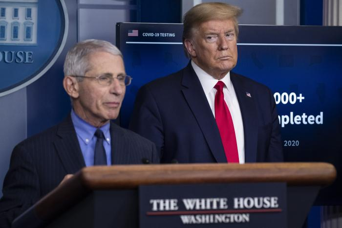Dr. Anthony Fauci, director of the National Institute of Allergy and Infectious Diseases, speaks about the coronavirus, as President Donald Trump listens, in the James Brady Press Briefing Room of the White House.