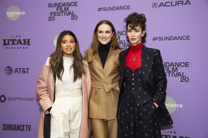 "Actors, from left, Gina Rodriguez and Evan Rachel Wood pose with writer-director Miranda July at the premiere of ""Kajillionaire"" during the 2020 Sundance Film Festival in Park City, Utah."