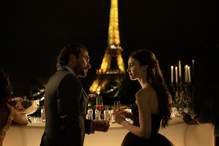 "William Abadie, left, and Lily Collins in a scene from ""Emily in Paris."""