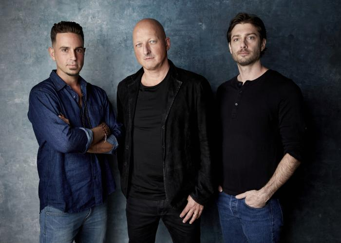 "James Safechuck, from right, director Dan Reed and Wade Robson pose for a portrait to promote the film ""Leaving Neverland"" during the Sundance Film Festival."