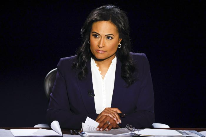 Moderator Kristen Welker of NBC News listens as President Donald Trump and Democratic presidential candidate former Vice President Joe Biden participate in the final presidential debate at Belmont University.
