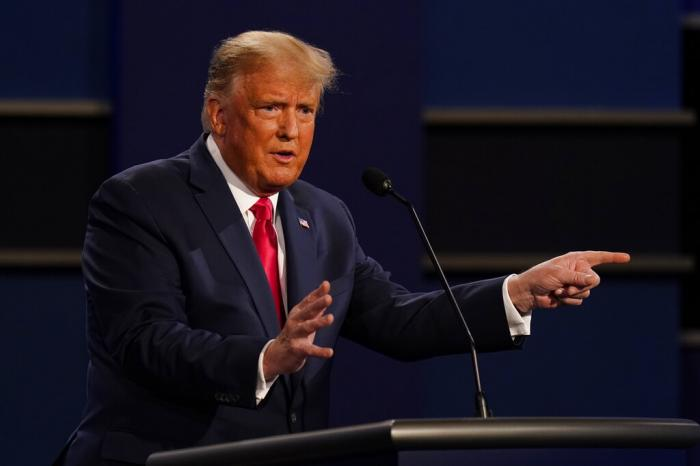 President Donald Trump gestures while speaking during the second and final presidential debate Thursday, Oct. 22, 2020, at Belmont University in Nashville, Tenn.