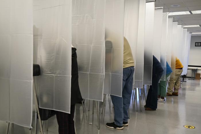Voters fill out their ballot during early voting at the Cuyahoga County Board of Elections in Cleveland.