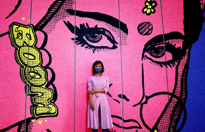 Artist Jas Charanjiva and her mural, 'Don't Mess With Me' at the Asian Art Museum