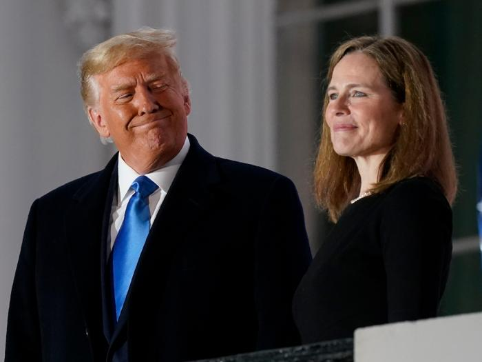 President Donald Trump and Amy Coney Barrett stand on the Blue Room Balcony after Supreme Court Justice Clarence Thomas administered the Constitutional Oath to her on the South Lawn of the White House White House in Washington, Monday, Oct. 26, 2020