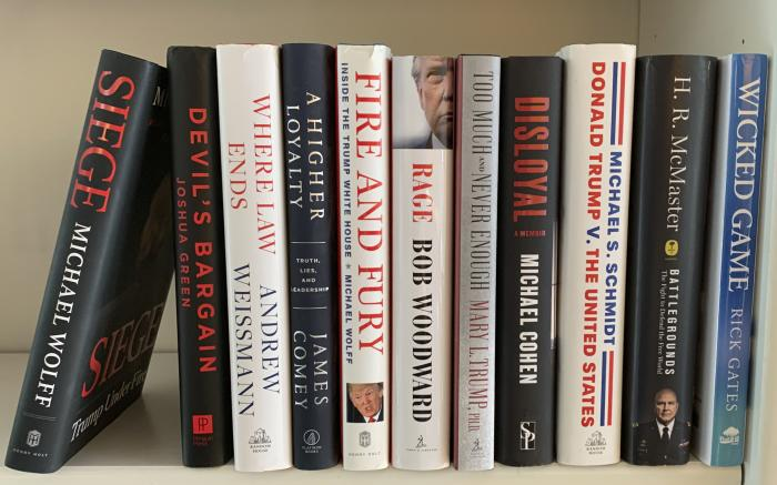 A collection of books about President Donald Trump.