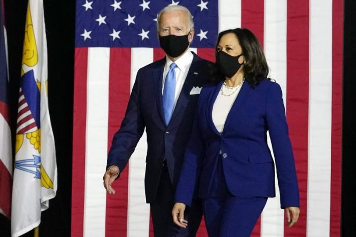 Democratic presidential candidate former Vice President Joe Biden and his running mate Sen. Kamala Harris, D-Calif., arrive to speak at a news conference at Alexis Dupont High School in Wilmington, Del.