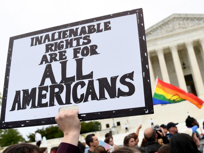 In this Oct. 8, 2019, file photo, protesters gather outside the Supreme Court in Washington where the Supreme Court is hearing arguments in the first case of LGBT rights since the retirement of Supreme Court Justice Anthony Kennedy