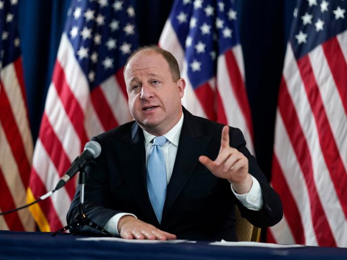 Colorado Gov. Jared Polis speaks during a news conference about the state's response to the rapid increase in COVID-19 cases, Tuesday, Nov. 24, 2020, in Denver