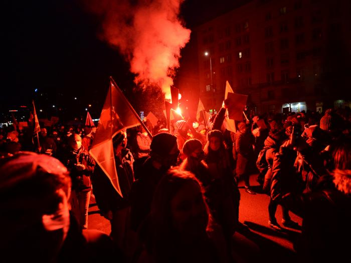 People demonstrate against police violence and an attempted restriction on abortion rights in Warsaw Poland, Saturday, Nov. 28, 2020