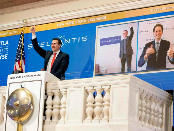 In this photo provided by the New York Stock Exchange, NYSE Vice Chairman John Tuttle, left, Stellantis CEO Carlos Taveras, center, and Chariman John Elkann, right, virtually ring the NYSE opening bell, Tuesday, Jan. 19. 2021