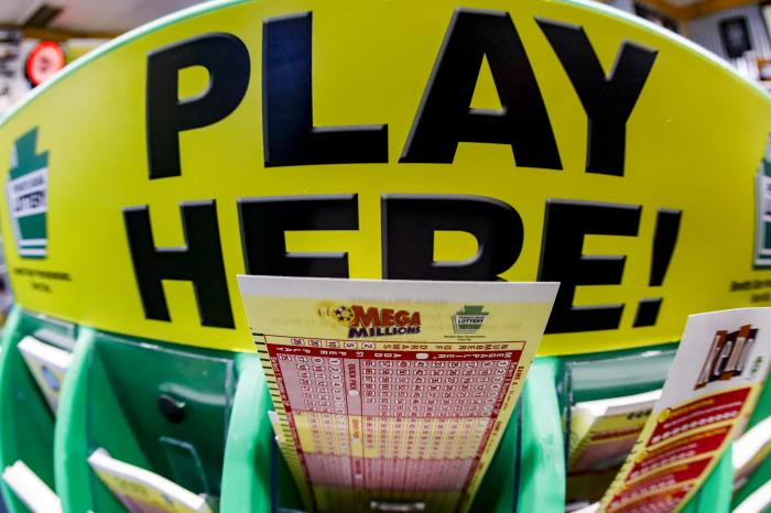 A Mega Millions playslip for those players preferring to choose the numbers they want to play is among the stacks of other lottery game playslips on display at a Smoker Friendly store, Friday, Jan. 22, 2021, in Cranberry Township, Pa.