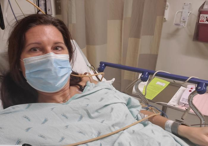 """Long hauler"" Jennifer Minhas found that once her fever and cough subsided after she got covid-19 last March, new symptoms emerged: chest pain, elevated heart rate and fatigue. ""I was kind of a zombie for months,"" she says."
