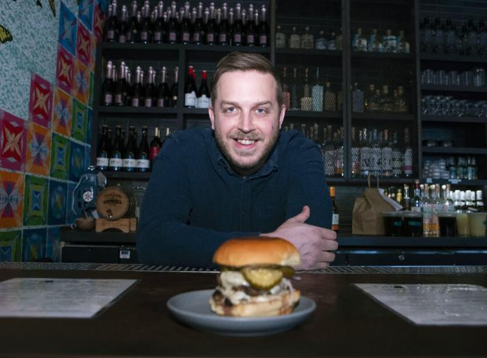 Josh Phillips, the co-owner of Espita, a stylish Mexican restaurant, holds a Ghostburger at his restaurant in downtown Washington.