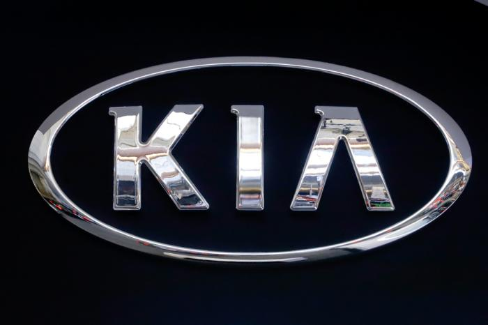 In this Feb. 14, 2019 file photo, the KIA logo is displayed on a sign at the 2019 Pittsburgh International Auto Show in Pittsburgh