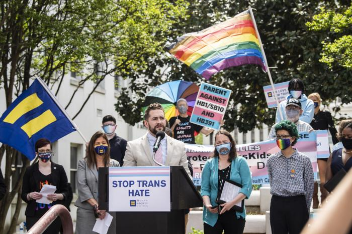 Alabama Rep. Neil Rafferty speaks in support of transgender rights during a rally outside the Alabama State House.