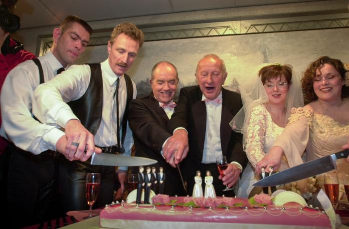 Peter Wittebrood-Lemke, from left, Frank Wittebrood, Ton Jansen, Louis Rogmans, Helene Faasen and Anne-Marie Thus cut the wedding cake after exchanging vows at Amsterdam's City Hall early Sunday, April 1, 2001