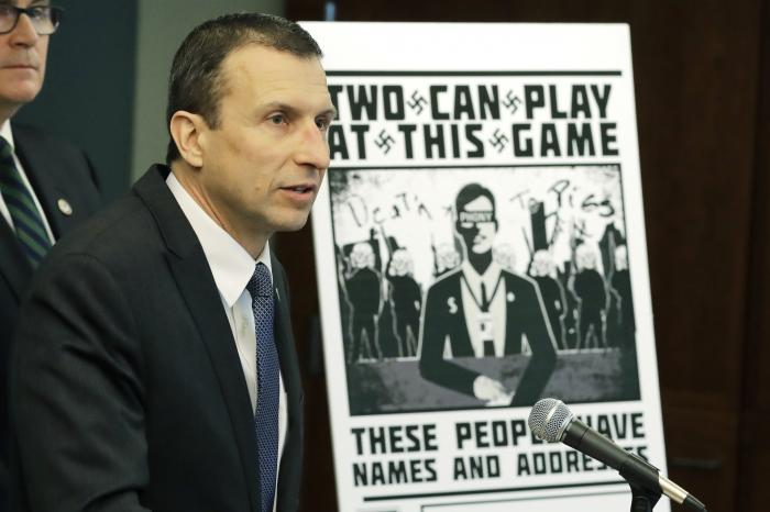 Raymond Duda, FBI Special Agent in Charge in Seattle, speaks as he stands next to a poster that was mailed earlier in the year to the home of Chris Ingalls, an investigative reporter with KING-TV during a news conference in Seattle.