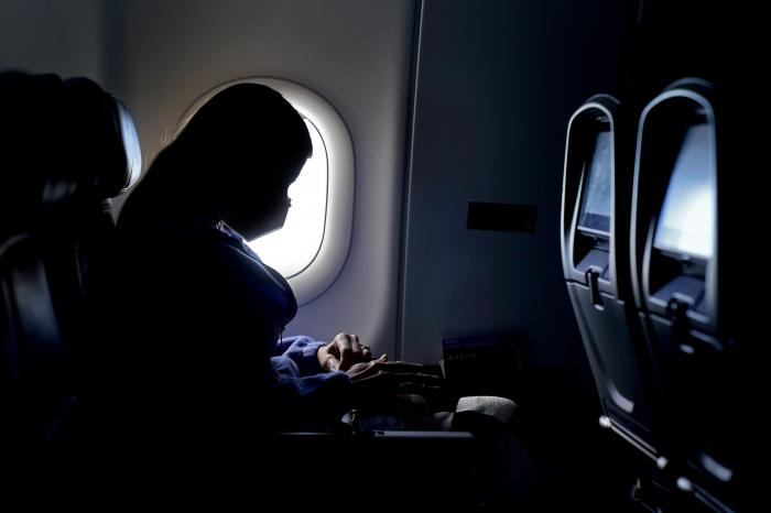 A passenger wears a face mask during an airline flight after taking off from Atlanta.
