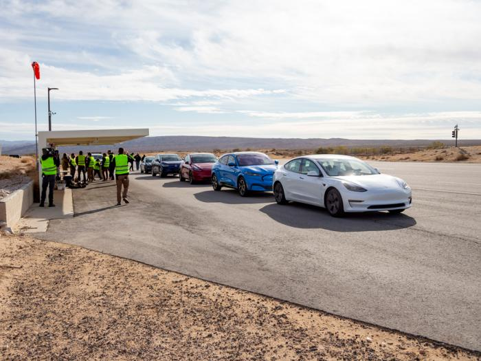 This undated photo by Edmunds shows five electric vehicles at a test track in the Mojave Desert, in California, undergoing testing for maximum range