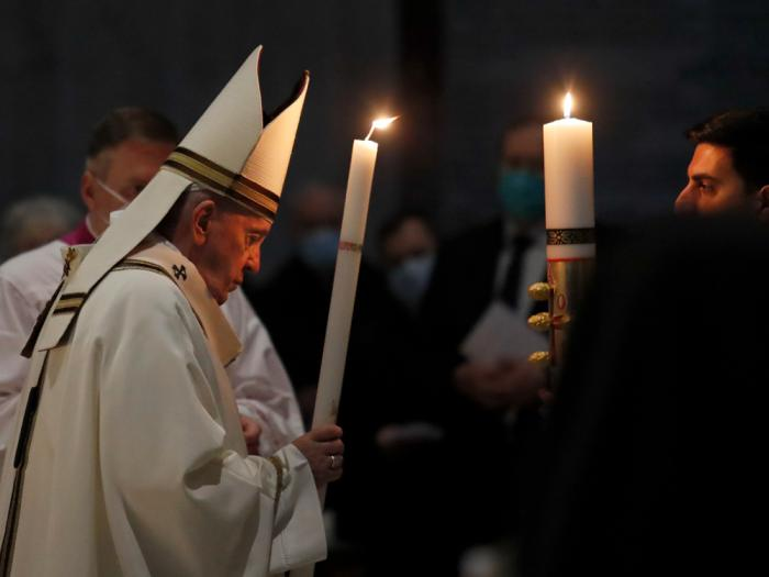 Pope Francis celebrates the Easter Vigil in a nearly empty St. Peter's Basilica as coronavirus pandemic restrictions stay in place for a second year running, at the Vatican, Saturday, April 3, 2021