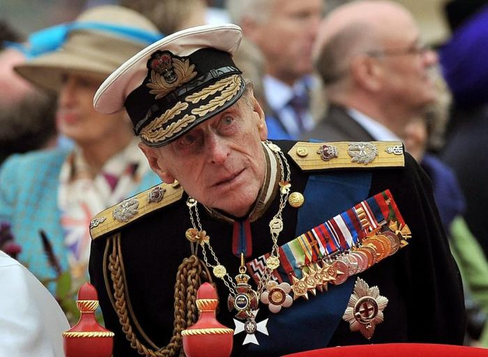 Prince Philip watching the proceedings from the royal barge during the Diamond Jubilee Pageant on the River Thames in London.