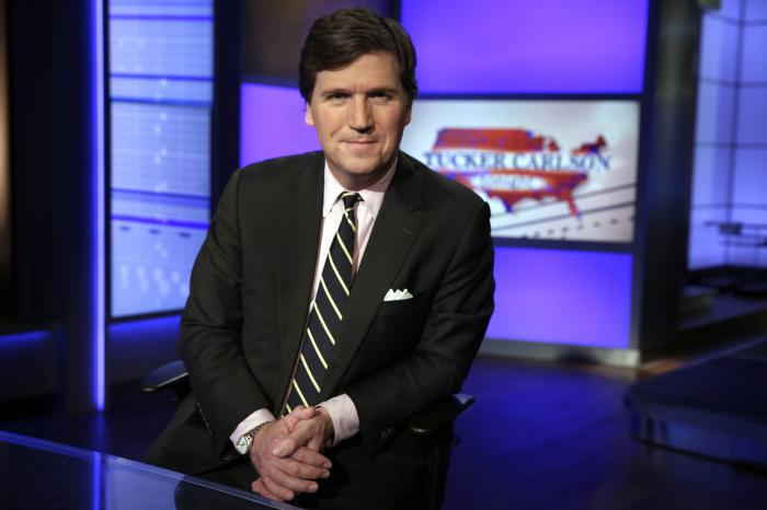 """In this Thursday, March 2, 2107 file photo, Tucker Carlson, host of """"Tucker Carlson Tonight,"""" poses for a photo in a Fox News Channel studio in New York"""