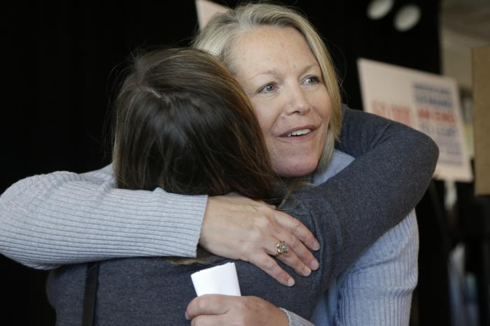 in this Oct. 22, 2013 file photo, Mount St. Mary school teacher then, Tippi McCullough, right, is hugged by a supporter after a Little Rock, Ark.