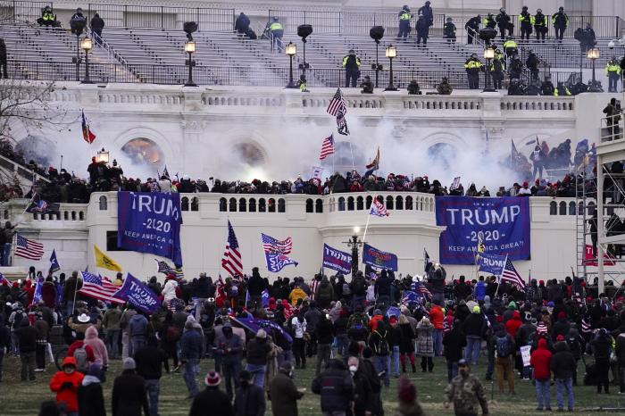 In this Wednesday, Jan. 6, 2021, file photo, violent rioters storm the Capitol, in Washington.