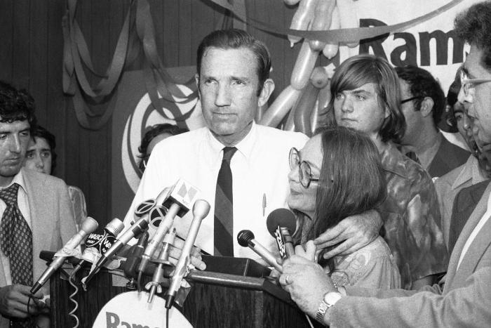 In this Wednesday, Sept. 14, 1976 file photo, Ramsey Clark, Democratic candidate for the U.S. Senate, center, speaks at Lincoln Center in New York.
